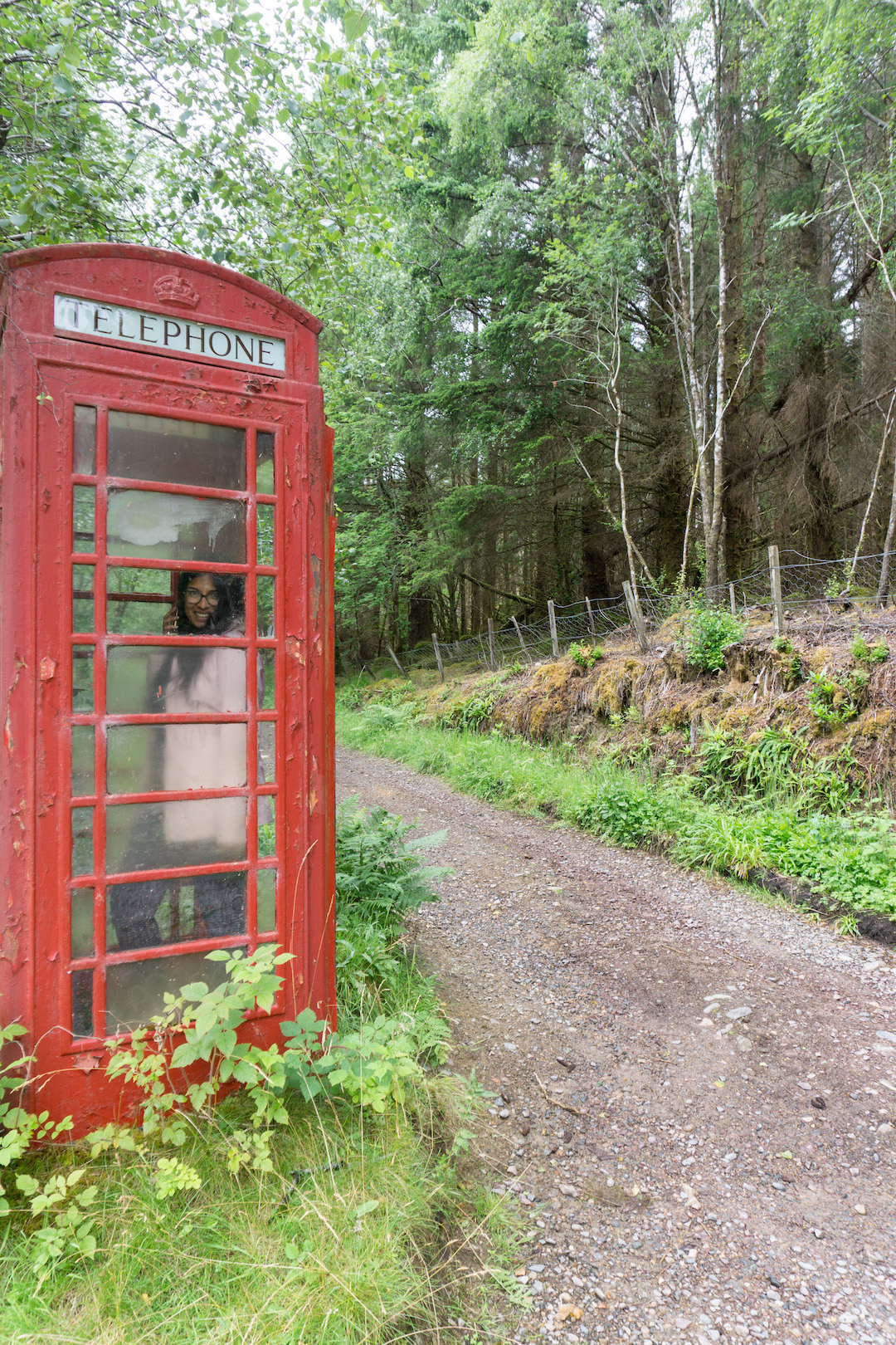 Red telephone booth in the Scottish countryside