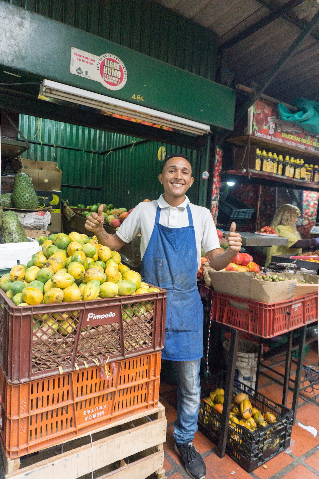 A fruit seller at Minorista Market in Medellin